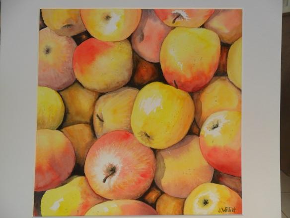 Les pommes jaunes et rouges